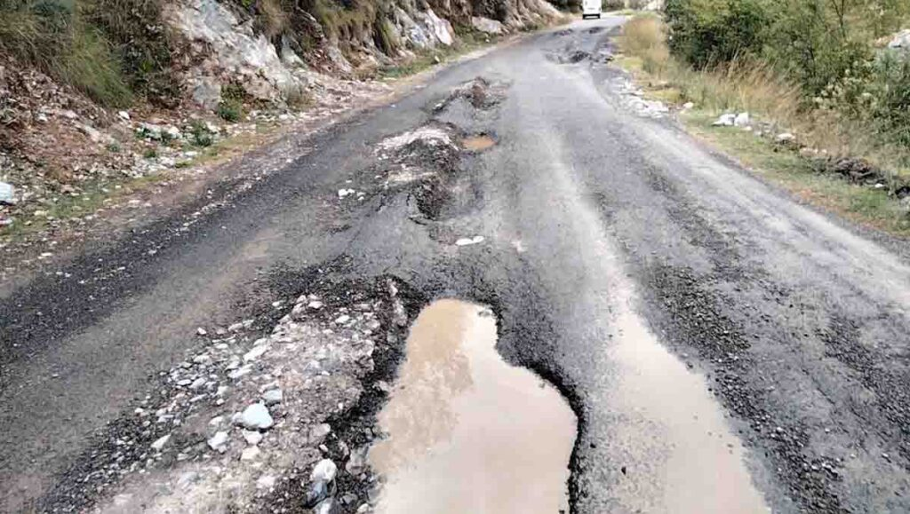 Load trucks destroyed the Khanda Khuh Road, which was blacktoped six months ago